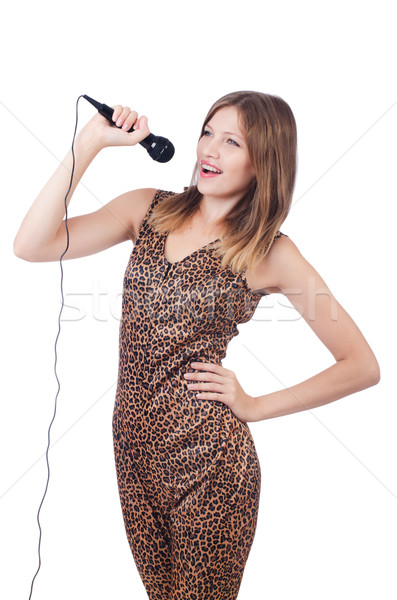 Stock photo: Woman singer with microphone on white