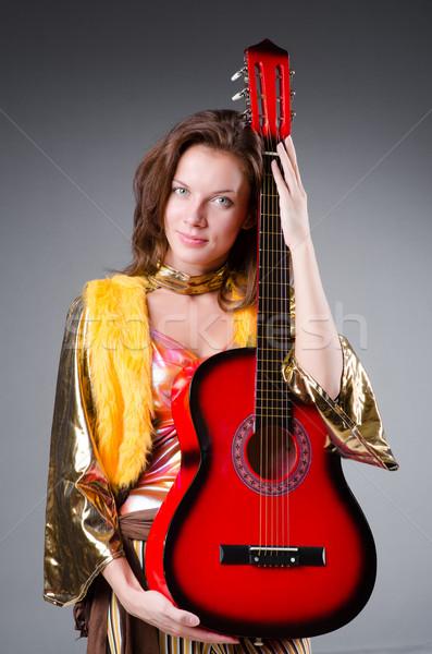Chitarrista rosso strumento musica party sfondo Foto d'archivio © Elnur