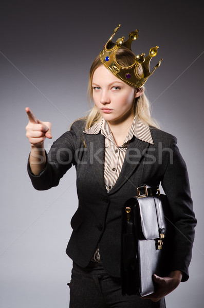 Pretty businessman with crown isolated on gray Stock photo © Elnur