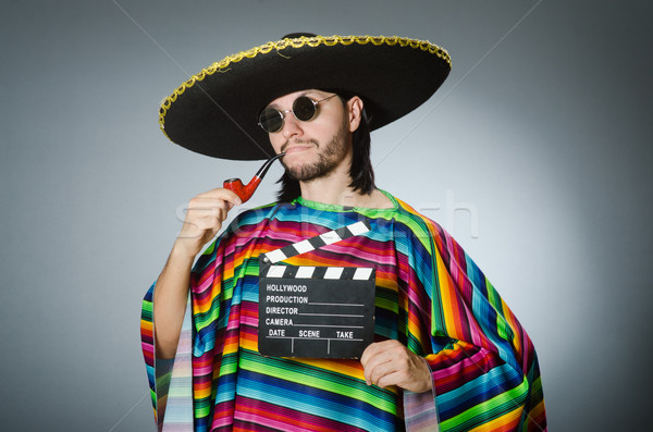 Mexican man with movie board Stock photo © Elnur