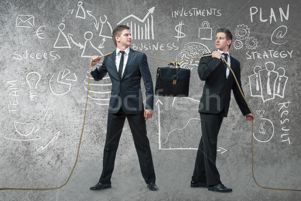 Twin brothers with various business concepts Stock photo © Elnur