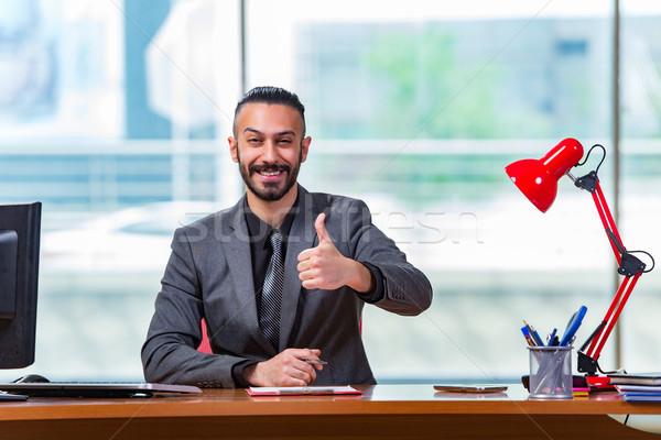 Man with his thumbs up in the office desk Stock photo © Elnur