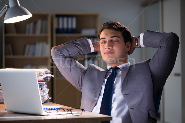 The businessman staying in the office for long hours Stock photo © Elnur