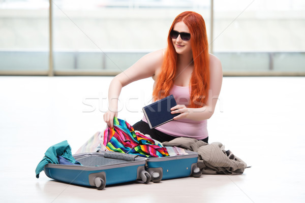 Young woman packing for travel vacation Stock photo © Elnur