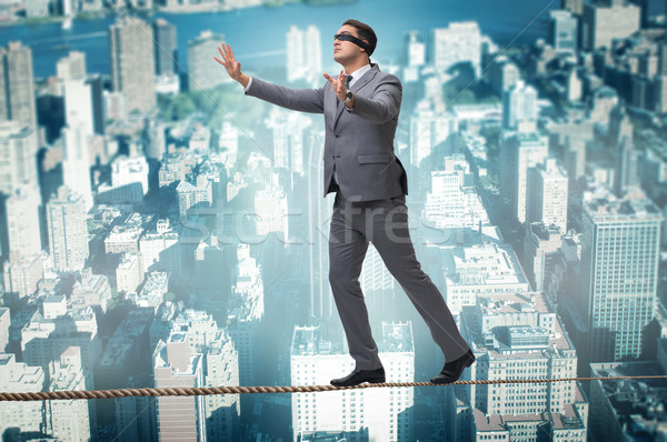 Man walking in tight rope blindfold Stock photo © Elnur
