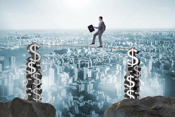 Businessman walking on tight rope Stock photo © Elnur
