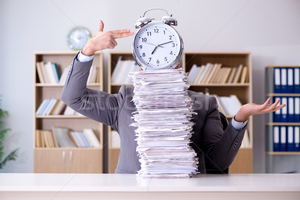 Businessman struggling to meet challenging deadlines Stock photo © Elnur