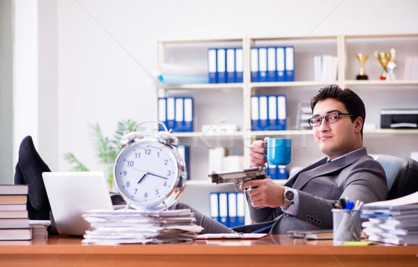 Jeunes affaires travaux fusil portable Photo stock © Elnur