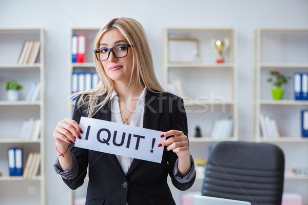 Young businesswoman with message in the office Stock photo © Elnur
