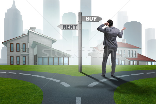 Businessman at crossroads betweem buying and renting Stock photo © Elnur