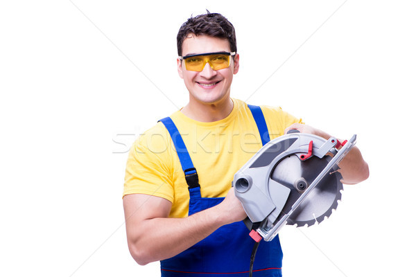 Carpenter wearing coveralls with circular saw isolated on white Stock photo © Elnur
