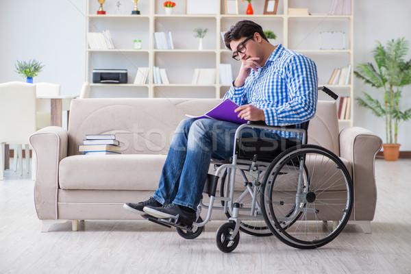 Jovem estudante cadeira de rodas incapacidade casa livro Foto stock © Elnur