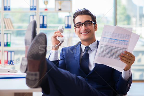 Businessman employee talking on the office phone Stock photo © Elnur