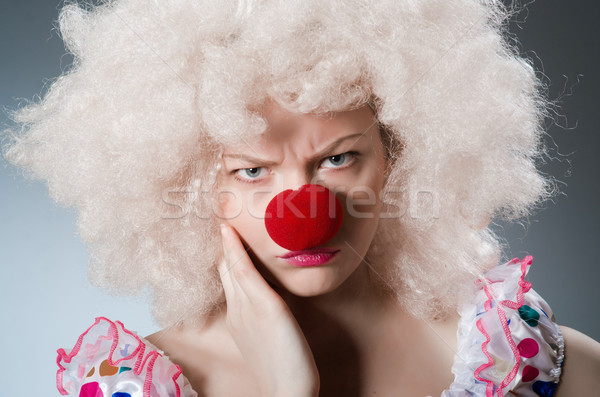 Clown with white wig against grey background Stock photo © Elnur