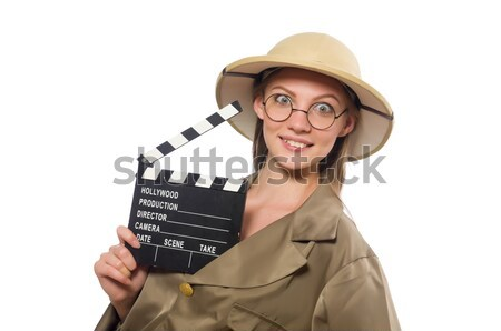 Beautiful girl holding hand gun and clapperboard isolated on whi Stock photo © Elnur