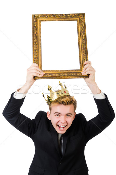 Young businessman with crown and picture frame isolated on white Stock photo © Elnur