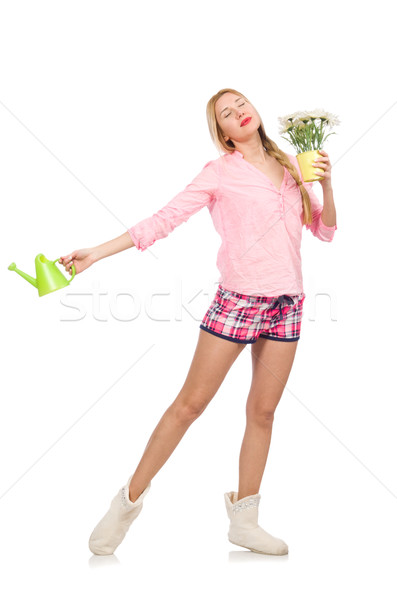 Stock photo: Pretty girl holding watering can and flowers isolated on white