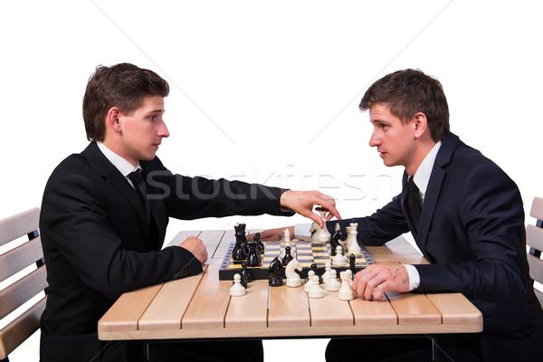 Gemelo hermanos jugando ajedrez aislado blanco Foto stock © Elnur