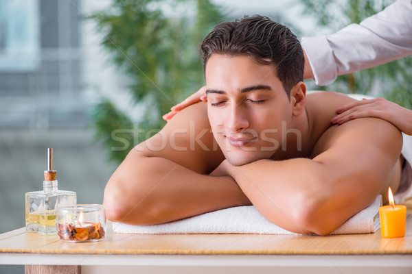 The handsome man during spa massaging session Stock photo © Elnur