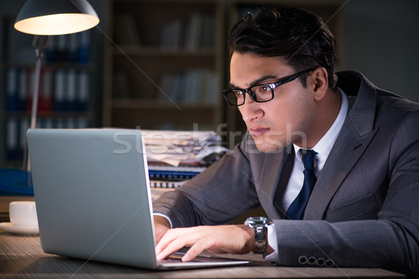 The man staying in the office for long hours Stock photo © Elnur