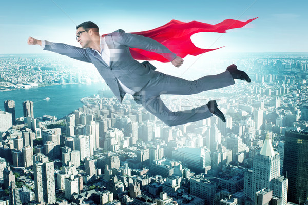The businessman in superhero concept with red cover Stock photo © Elnur