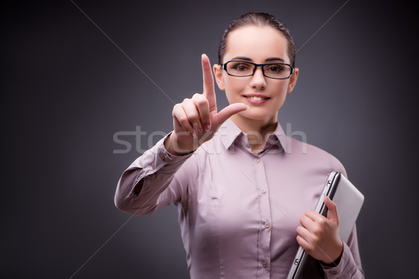 Businesswoman pressing virtual button in business concept Stock photo © Elnur