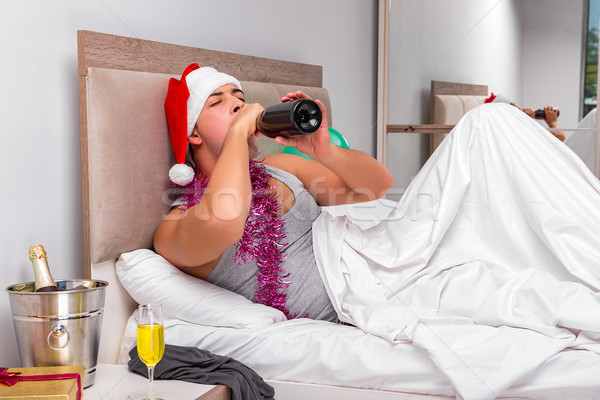 Młody człowiek kac ciężki imprezy biuro wina Zdjęcia stock © Elnur