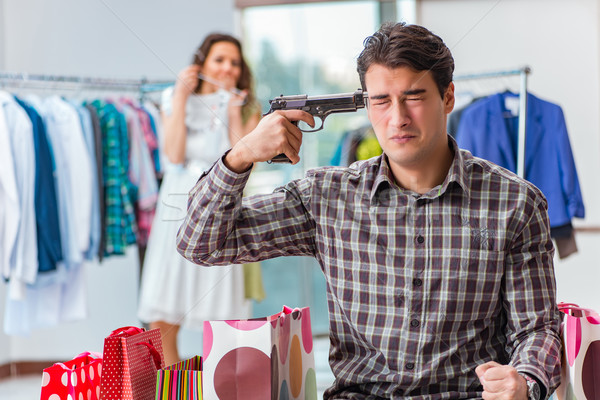 Stock photo: Man fed up with wife shopping in shop