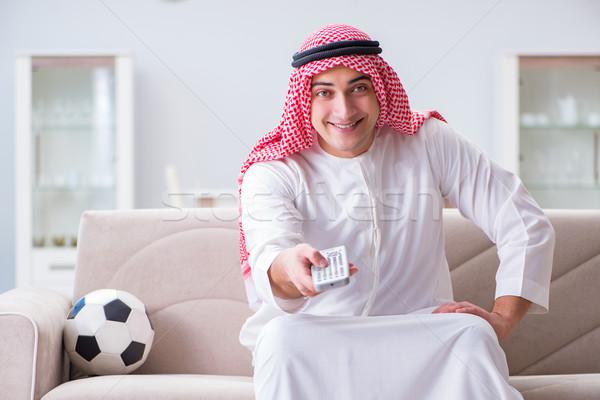 Arab man watching sport football at tv Stock photo © Elnur