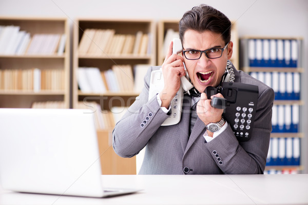 Angry helpdesk operator yelling in office Stock photo © Elnur