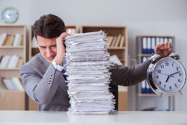 Businessman busy with paperwork in office Stock photo © Elnur