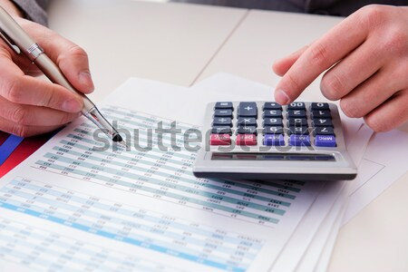 Finance analyst looking and financial reports Stock photo © Elnur