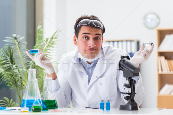 Male doctor working in the lab on virus vaccine Stock photo © Elnur