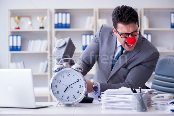 Payaso empresario oficina martillo despertador hombre Foto stock © Elnur