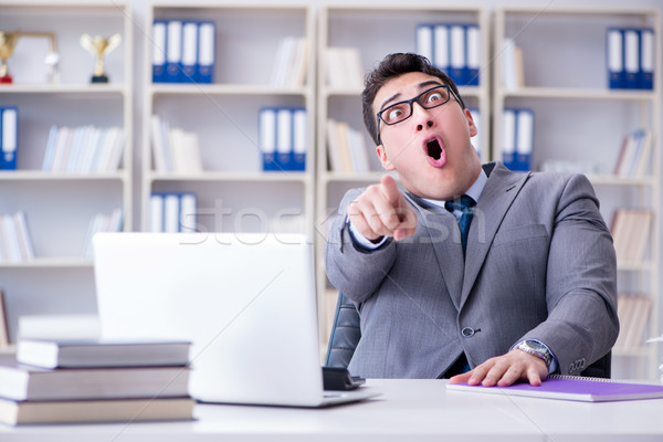 Funny businessman clown acting silly in the office Stock photo © Elnur