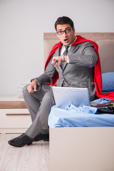 Super hero businesswoman working in bed Stock photo © Elnur