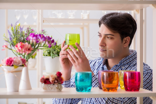 Young handsome man shopping in shop Stock photo © Elnur