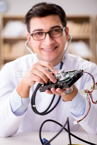 Proffesional repairman repairing broken hard drive Stock photo © Elnur