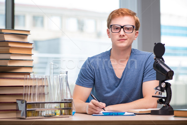 Young student tired and exhausted preparing for chemistry exam Stock photo © Elnur