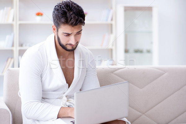 Young man freelancer working from home on a laptop Stock photo © Elnur