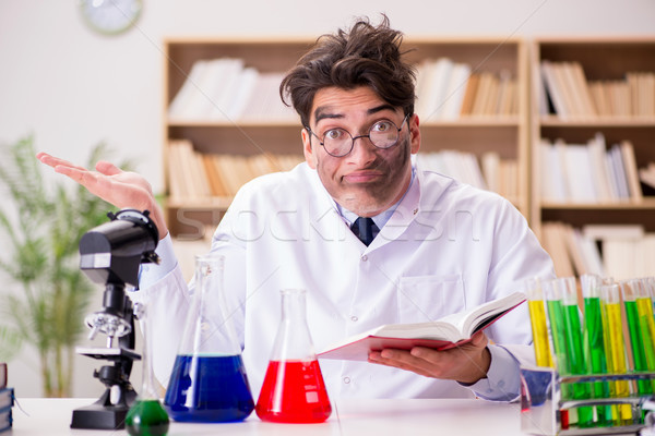 Mad crazy scientist doctor doing experiments in a laboratory Stock photo © Elnur