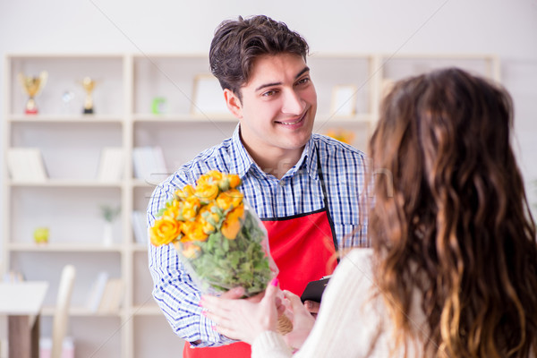 The flower shop assistant selling flowers to female customer Stock photo © Elnur