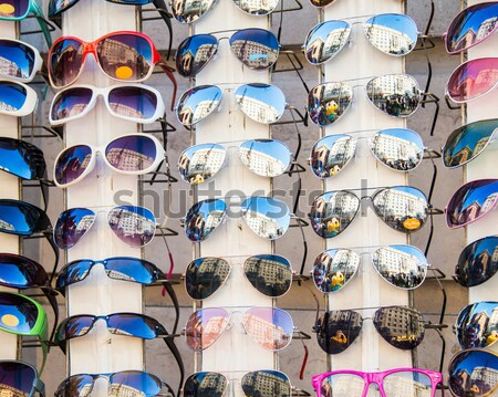 Many sunglasses on display in shop Stock photo © Elnur