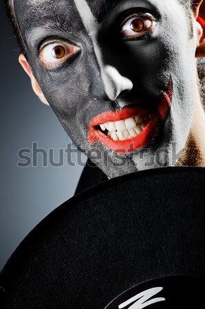 Scary woman with metal axe in halloween concept Stock photo © Elnur