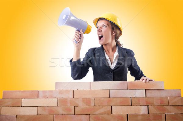 Kobieta budowniczy głośnik biały działalności budowy Zdjęcia stock © Elnur