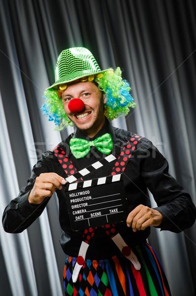 Clown with movie clapper board Stock photo © Elnur