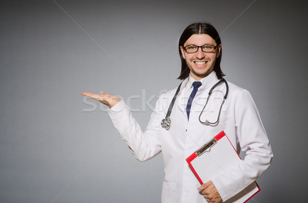Male doctor with diary against gray Stock photo © Elnur