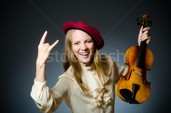 Woman violin player in musical concept Stock photo © Elnur