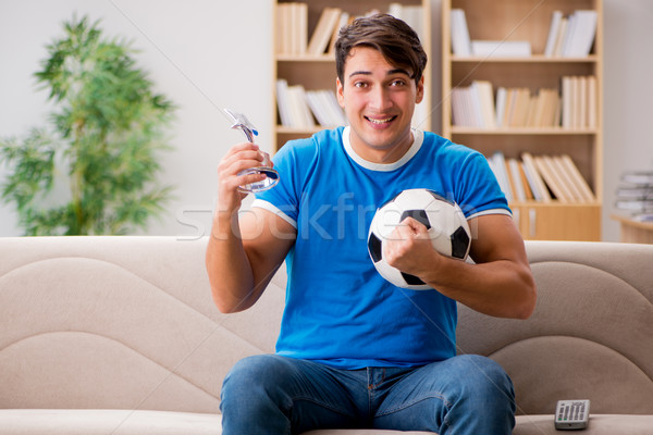 Man watching football at home sitting in couch Stock photo © Elnur