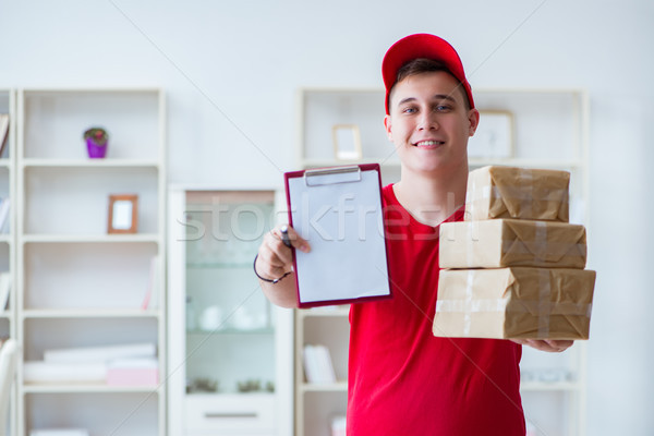 Post man delivering a parcel package Stock photo © Elnur